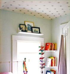 Fun twist -- pale aqua wall with wall papered ceiling