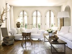 Love the simplicity, wood + white, and rounded couch