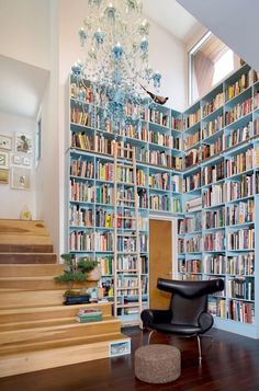 Love this reading area with the high shelves and the natural light.