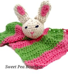 This uniquely adorable crochet bunny baby blanket is perfect for your sweet baby. It measures 14 by 17 and the bunny toy is attached to the blanket. The blanket and bunny are made with soft acrylic yarn. It is perfect for any baby gift. The blanket portion is made with a bright pink and bright green. If you would like different colors, pleas convo me and I will be happy to meet your request.   To continue shopping, click here: https://www.etsy.com/shop/sweetpeaboutique15  Please see our…