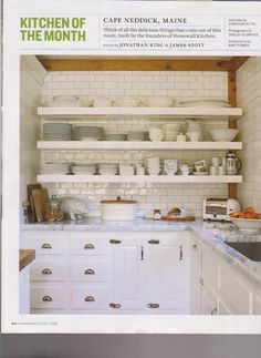 Subway tiles line the back of these open shelves above traditional white cabinetry and Carrara marble countertops. I like the way they took the tiles to the ceiling. Alabaster tile from Capozza Tile Company. Shelves & Cabinets are painted Benjamin Moore's Atrium White.