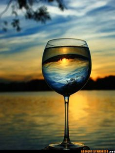 Sipping a glass of sunset.  Nothing tastes better......nice photograph....