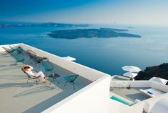 "stylish ""string"" basket chairs grace hotel santorini greece via Mr & Mrs Smith -"