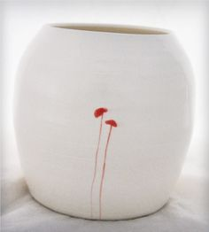 White Ceramic Vase with Red Poppies