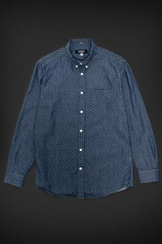 A spring twist on the standard chambray staple, this shirt is made with a jacquard pattern, meaning the dots are woven into the fabric, not printed on . The polka dot pattern is ideal for layering, and the jacquard adds a pop of texture to your outfit. Made from a lightweight cotton, this piece will last you all summer long. Features4oz, 100% Cotton Back Collar Button Flat-Felled Seams Single Chest Patch Pocket Custom Stock Buttons