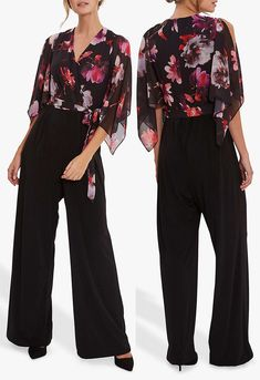 This floral jumpsuit features a deep v-neck, floral chiffon wrap style bodice contrasting the with jersey side leg trousers. With cape like sleeves and tie waist, team with heels for an elegant look at an Autumn Wedding. Floral Jumpsuit for an Autumn Wedding . Autumn Winter Fashion 2020. What to wear to an Autumn wedding. What to wear for an Autumn Wedding 2020. Autumn Wedding Guest Outfits 2020. Gina Bacconi Chloe Jumpsuit. Formal Jumpsuits for Autumn 2020. #jumpsuits #fashion… Fall Wedding Outfits, Winter Fashion Outfits, Autumn Wedding, Autumn Fashion, Floral Jumpsuit, Jumpsuit Dress, Bright Blue Dresses, Mother Of The Bride Hats, Kentucky Derby Outfit