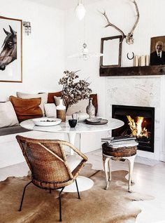 rustic interiors white dining space with banquette and fireplace