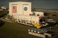 https://flic.kr/p/MdGHDJ | Antares Rocket Rollout (NHQ201610130100) | The Orbital ATK Antares rocket, with the Cygnus spacecraft onboard, is rolled out of the Horizontal Integration Facility (HIF) to begin the approximately half-mile journey to launch Pad-0A, Thursday, Oct. 13, 2016 at NASA's Wallops Flight Facility in Virginia. Orbital ATK's sixth contracted cargo resupply mission with NASA to the International Space Station will deliver over 5,100 pounds of science and research, crew…