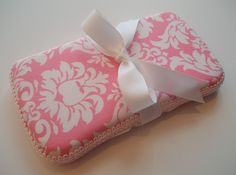 Pink cover for a take-along wipes case