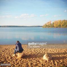 Woman sitting on stone on Senezh lake coast in Solnechnogorsk,... #solnechnogorsk: Woman sitting on stone on Senezh lake… #solnechnogorsk