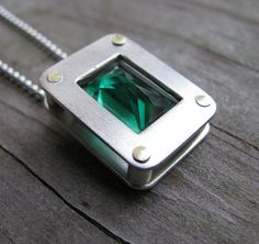Love the stone and the rivets. Green Topaz Sandwich pendant