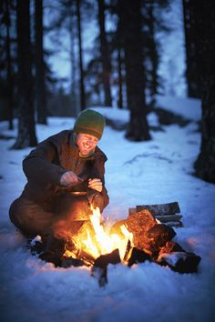 Marcus Eldh, @wildsweden tour guide, makes coffee on a fire in the woods of Bergslagen in central Sweden whilst tracking the elusive wolf // photo by Jonathan Gregson #sweden #winter