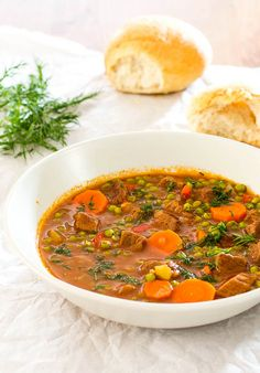 A classic Romanian recipe for beef and pea stew, flavored with Herbes de Provence. Beef Recipes, Italian Recipes, Soup Recipes, Cooking Recipes, Romania Food, Romania Travel, English Food, International Recipes, Soup And Salad