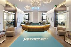 Yammer's impressive reception area features art deco columns of the original building. From sealed concrete floors to high exposed ceiling, this reception area reflects the high end of the social network that Yammer represents.