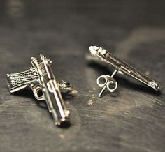 Gun stud earrings..with a few little diamonds on them and they would be perfect!!! Love!