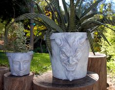 Use Halloween masks (or any mask) to make a face to add to a planter.  Hmmm... bet I could improve on this...