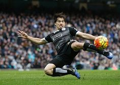 Leicester City's Japanese striker Shinji Okazaki attempts an acrobatic volley at the Etihad. The Premier League leaders Leicester stunned rivals Manchester City with a 3-1 victory to move five points clear