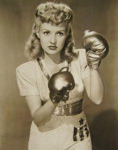 FOOTLIGHT SERENADE (1942) - Betty Grable puts up her dukes - 20th Century-Fox - Publicity Still.