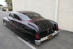 1951 Merc in flames and black paint with a nearly perfect chop top with a 49/50 rear window. Pic 1