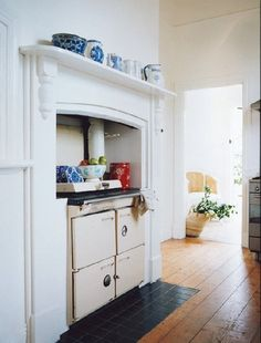 Old World Stove in Alcove w/ Blue & White Porcelain on Mantle Cosy Kitchen, Kitchen Stove, Aga Stove, French Kitchen, Rustic Kitchen, Rue Verte, Wood Stove Cooking, Interior Inspiration, Kitchen Inspiration