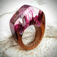 I made this unique ring combining teak wood and eco-friendly epoxy resin. Hand shaped and sanded nicely to obtain a very smooth and rounded surface all around. Finished with multiple very thin layers of varnished tung oil for maximum wear and moisture resistance . If needed, you may
