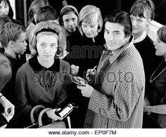 Der französische Schauspieler Pierre Brice gibt Autogramme nach der Sendung 'Werner Müllers Schlagermagazin' am 11.12.1965. Fren - Stock Image