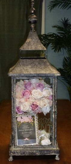 Preserved wedding bouquet in lantern / http://www.himisspuff.com/100-unique-and-romantic-lantern-wedding-ideas/7/