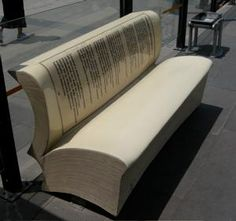 Have a seat on a good book! Think this cool book bench is someplace in Europe.