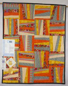 Orange wonky rails quilt by Lilley Robb, 2008 quilt show, photo by Helen at Patch Work of Mini Grey