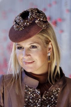 Princess Máxima | The Royal Hats Blog | In between the births of her daughters, Maxima's hat style became more adventurous. She dabbled with red statement hats, straw turbans, bejeweled pillboxes, Chanel-esque veiled headbands, fascinators, and orange dramatic brims.
