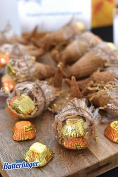 Share the crispety, crunchety, peanut-buttery goodness of NEW BUTTERFINGER® peanut butter cup minis with your Halloween party guests by creating these Crispety Crunchety Cornucopias. Not only are they delicious to munch on, but they double as a decoration or party favor. Click to see how you can make this easy DIY decoration for Halloween or Thanksgiving  in just a few simple steps!