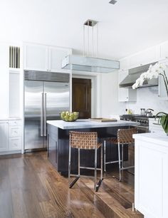 Modern White Kitchen with Woven Leather Stools