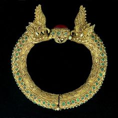 19th century, Mandalay period 22K yellow gold antique Royal Burmese bracelet, set with a 10ct. Burmese Ruby.
