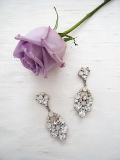 Sparkling chandelier earrings. Open teardrop design with clear & white opal crystals. Designed by Erin Cole Bride. #afterthedress