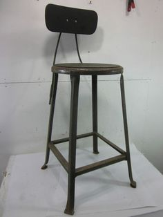 $124.99 -   Vintage Metal Tall Industrial Shop Stool  http://www.ebay.com/itm/Vintage-Metal-Tall-Industrial-Shop-Stool-/360591458225?pt=US_Bar_Stools=item53f4ecffb1