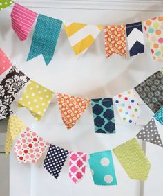 scrappy garland: sew a bunting with scraps, just sew together, no interfacing, no backing up the fabrics.