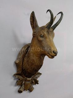 a large carved wood chamois head 1900