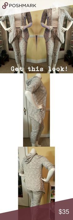 New york and company hooded jogging suit. Grey and white jogging suit. Jacket is asymmetrical, longer in the front with a hood. Pants are jogger style that gather at the ankle. Has 4 pockets on pants and 2 on jacket. Size medium top and bottom. White cami is a free gift with purchase. Worn once excellent condition. New York & Company Other