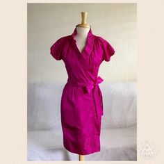 """Diane Von Furstenberg Victoire Wrap Dress Size 6.  This dress is updated in a high-gloss formal faille.  The color is Party (Pink).  It has a ruffled surprise neckline, tie waist, elasticized short sleeves, pleated detail, 100% Silk.  Measures about 37"""" from shoulder to hem.  Worn once and is in excellent condition.  Negotiable, reasonable offers welcome.  Use the offer button.  No trades/no PayPal. Diane von Furstenberg Dresses Midi"""