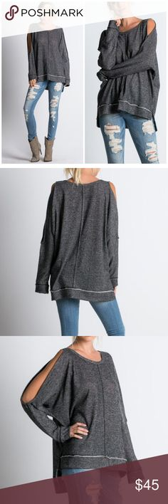 New Arrival Fabulous Cut Sleeve Tunic Black distressed feel of a tunic high low hemline with cut out sleeves . Loose style looks great with skinny denim or shorts . Nwot . Vivacouture Tops