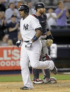 GAME 11: Tuesday, April 17, 2012 - New York Yankees' Andruw Jones crosses home plate after hitting a home run during the fourth inning of a baseball game against the Minnesota Twins at Yankee Stadium in New York. The Yankees beat the Twins 8-3. (AP Photo/Seth Wenig)