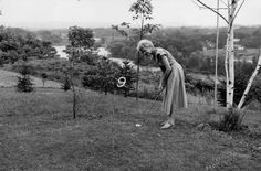 Senator Margaret Chase Smith testing the golf course she designed for President Eisenhower at her Skowhegan, Maine home, 1955.