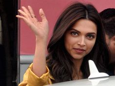 Bollywood actor Deepika Padukone waves to her fans during shooting of her new film 'Tamasha' in front of old Kolkata Airport terminal.