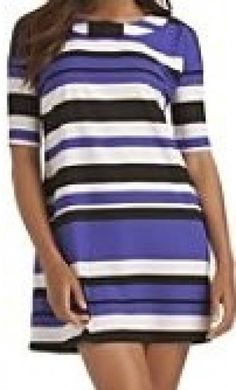 Kourtney wears a Kardashian Kollection striped loose dress on Kourtney & Kim Take Miami