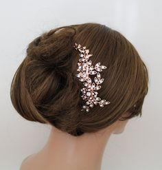 This unique couture Rose gold hair comb I created using an assortment of vintage floral and leaf stampings and settings I had professionally plated