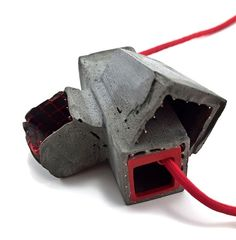 Demi Thomloudis. Necklace: Reassembled with Interior, 2013. Cement, steel, resin, pigment, sterling silver, wood, cord.