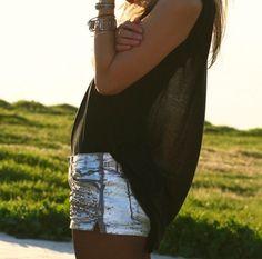 Silver denim shorts and black sheer tank