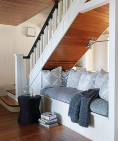 I like the wood under the stairs. Use beadboard to match ceiling? Also- newel at second step, slightly around the corner of landing.
