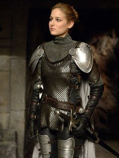 iris [chainmail on torso; no shoulder plating; plate bracers on forearms, add plate gauntlets, leg plate armor should cover the sides of the legs and also include plates that cover the calves; include metal-toed leather boots]