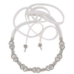 This satin silk headband delicately adorned with Pearls, compliments any style dress. To give any bride a look of innocence. This